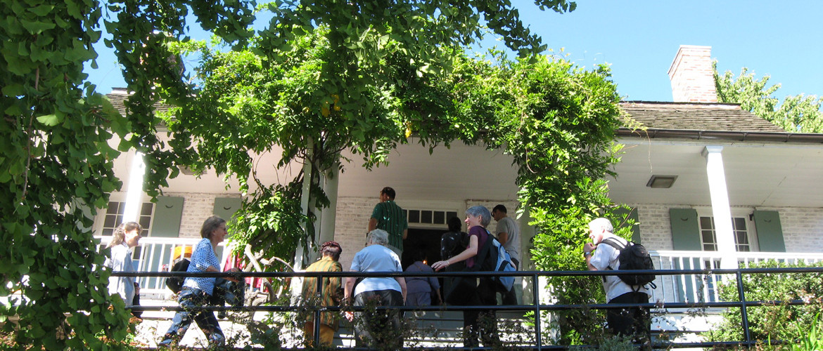 People entering the Dyckman Farmhouse Museum.